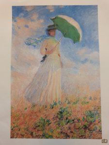 Monet, vrouw met parasol in het veld